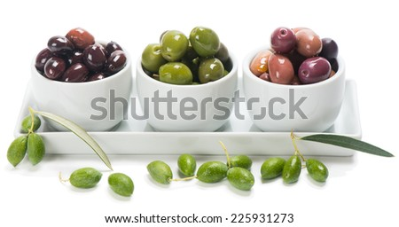 assortment of pickled olives in small individual dishes for snacks,  isolated on white  - stock photo