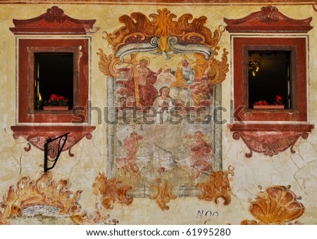 Assumption of the Virgin. Renovated fresco between ornamental windows. Bardejov; Slovakia - UNESCO World Heritage town. - stock photo