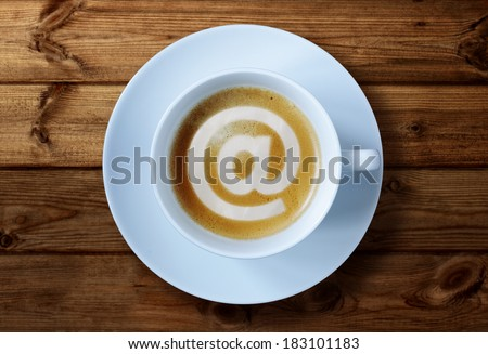 'at' symbol in coffee cup concept for social media, e-mai, internet cafe or business meeting - stock photo