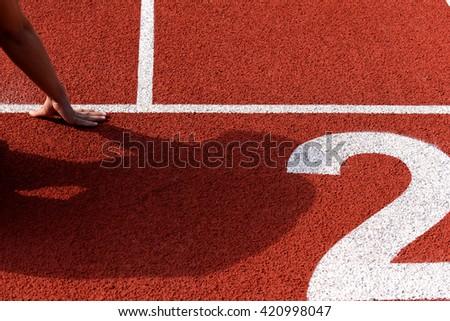 Athlete runner feet running on treadmill - stock photo