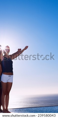 attractive young woman and man doing yoga  - stock photo