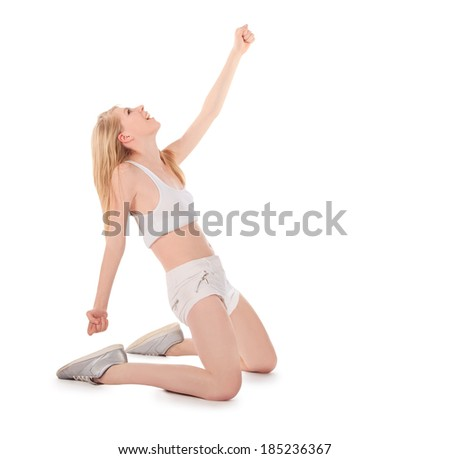 attractive young woman celebrating winning  - stock photo