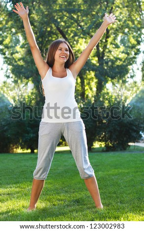 Attractive young woman having fun outdoors - stock photo