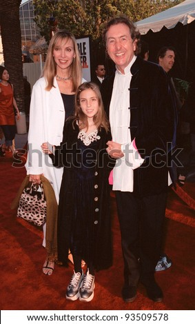 "10AUG99: Monty Python star ERIC IDLE with wife Tania & daughter Lily at the Los Angeles premiere of  ""Bowfinger"" which stars Eddie Murphy & Steve Martin.  Paul Smith / Featureflash - stock photo"