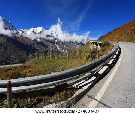 Austrian Alps. Excursion to the picturesque panoramic way Grossgloknershtrasse. Sunny day in early autumn. Great highway winds between hillsides yellowed.  The picture was taken Fisheye lens - stock photo