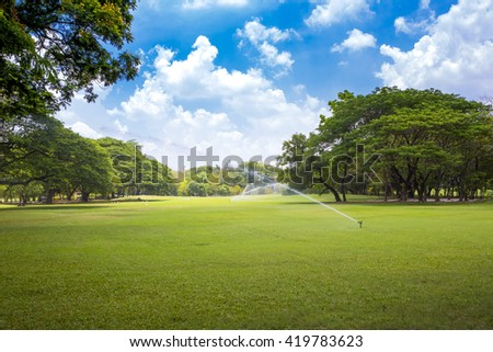 Automatic sprinklers watering lawns - stock photo