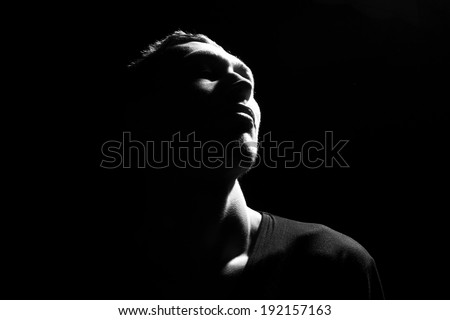 Awe. Male head profile silhouette .Dramatic theater performance - stock photo