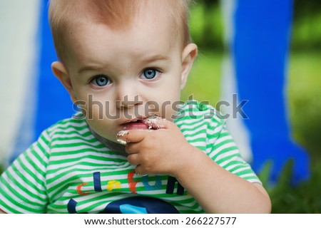 Baby boy with finger in his mouth - stock photo