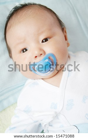 baby boy with pacifier. - stock photo