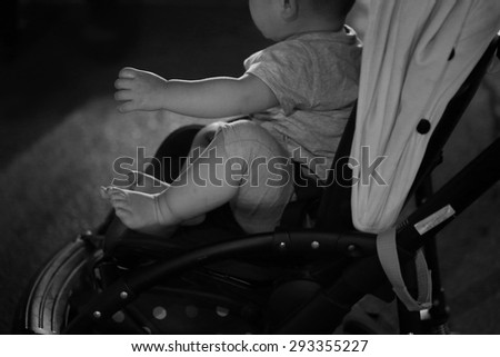 baby on cart - stock photo