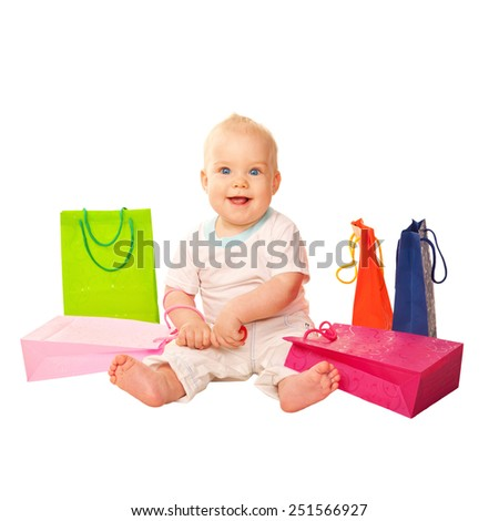 Baby shopping. Little kid with shopping bags. Isolated on white background - stock photo