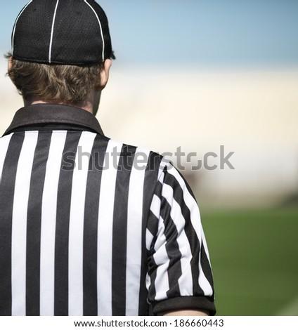 back of a football referee - stock photo