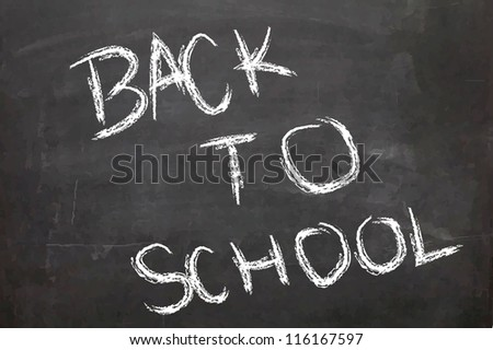 'Back to School' wrote on a chalk board - stock photo