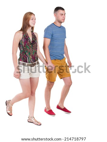 Back view going couple in shorts. walking friendly girl and guy holding hands. Rear view people collection. backside view of person. Isolated over white background.  - stock photo