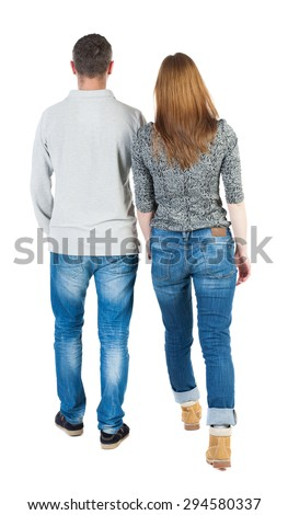 Back view going couple. walking friendly girl and guy holding hands. Rear view people collection. backside view of person.  Stylish couple holding hands walking near each other. - stock photo