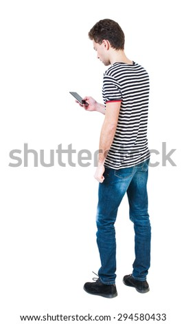 back view of man in suit  talking on mobile phone.    rear view people collection. Isolated over white background. backside view of person. The guy in the striped shirt looking at the cell phone. - stock photo