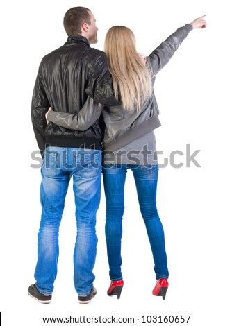 Back view of young couple pointing (woman and man). guy  and  girl  looking into the distance. Rear view people collection.  backside view of person.  Isolated over white background. - stock photo