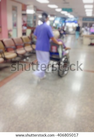Background blur Hospital patients are wheelchair in hospital. - stock photo
