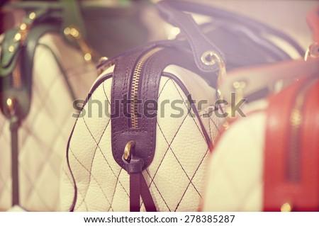 Background of fashion handbags. vintage. - stock photo