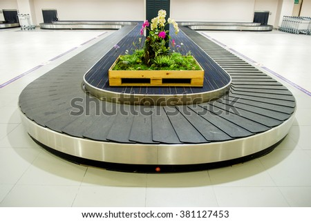 baggage pick up area at an airport  - stock photo