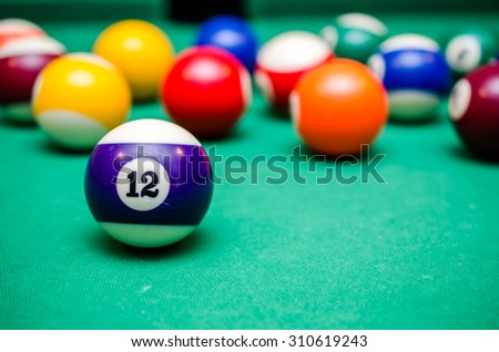 12 Ball from pool or billiards on a billiard table - stock photo