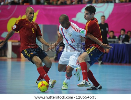 BANGKOK, THAILAND - NOV 14:Sirilo of Russia (w) in action during the FIFA Futsal World Cup Quarterfinal Round between Spain and Russia at Nimibutr Stadium on Nov14,2012 in Bangkok, Thailand. - stock photo