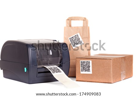 barcode printer and packaging boxes marked with a bar code - stock photo