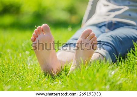 bare feet on green grass - stock photo