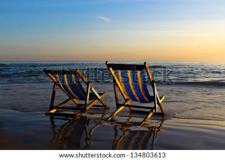 Beach Chairs at Sunrise on the beach. Huahin Thailand - stock photo