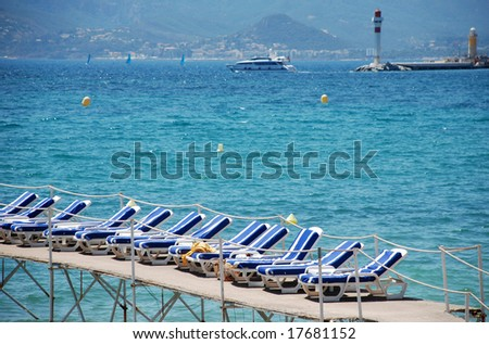 beach chairs near the croisette in Cannes - stock photo