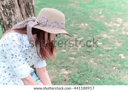 Beautiful Asian girl sad love unrequited, she vacant all day - stock photo