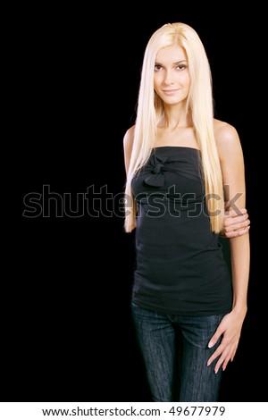 Beautiful blond girl, isolated on black background. - stock photo