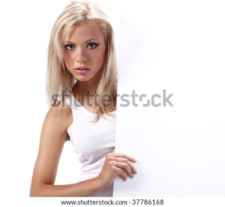 Beautiful blonde girl showing empty white board - stock photo