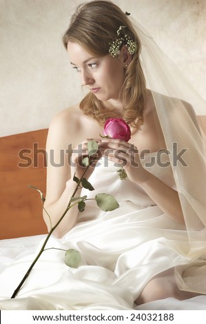 beautiful bride with a red rose - stock photo
