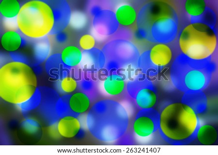 Beautiful bubbles effect illustration showing a vibrant Blue, yellow and green background - stock photo
