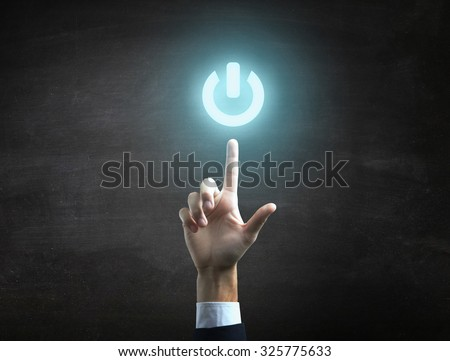 beautiful Business male hand indicating power on icon. - stock photo