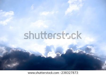 beautiful cloudy blue sky in the wild Atlantic way, Ireland with sunbeams - stock photo
