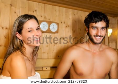 Beautiful couple relaxing while taking a sauna - stock photo