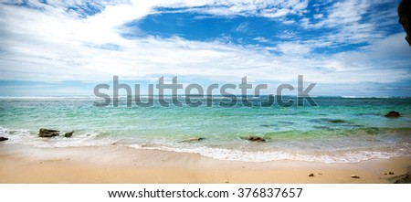 beautiful empty beach, serene tropical place  - stock photo