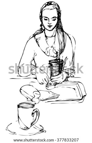 beautiful girl drinking at a table in a cafe - stock photo