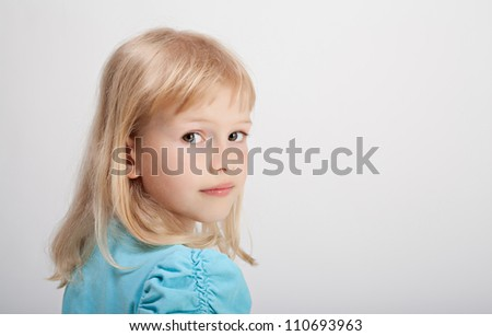 Beautiful girl in blue t-shirt on white background - stock photo
