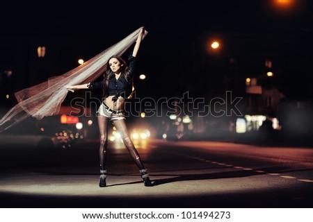 beautiful girl in fashion style. night city background - stock photo