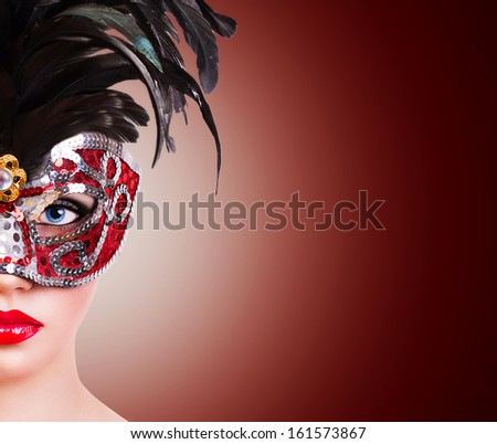 Beautiful girl in red carnival mask  - stock photo