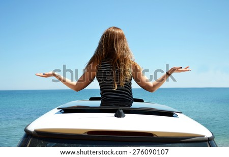 beautiful girl shows the way - stock photo
