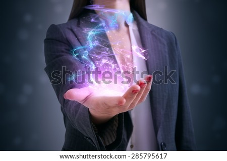 beautiful motley glow in womans palm - stock photo