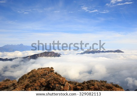 beautiful rolling clouds and mountain landscape - stock photo