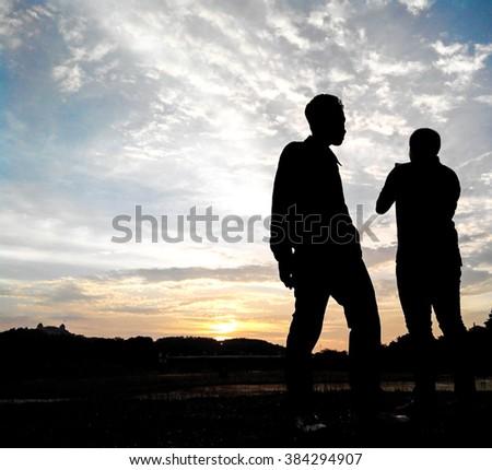 beautiful scene in silhouetted sunset - stock photo