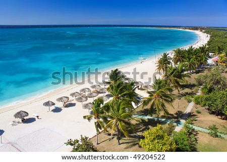 Beautiful tropical  beach at the Caribbean island with white sands and  stunning turquoise waters - stock photo