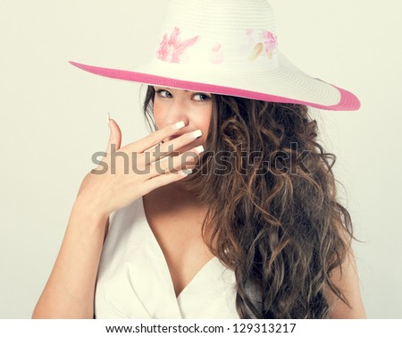beautiful woman in a white hat from the sun. - stock photo