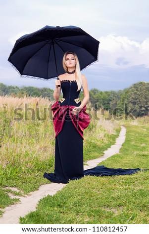 Beautiful woman in vintage dress - stock photo